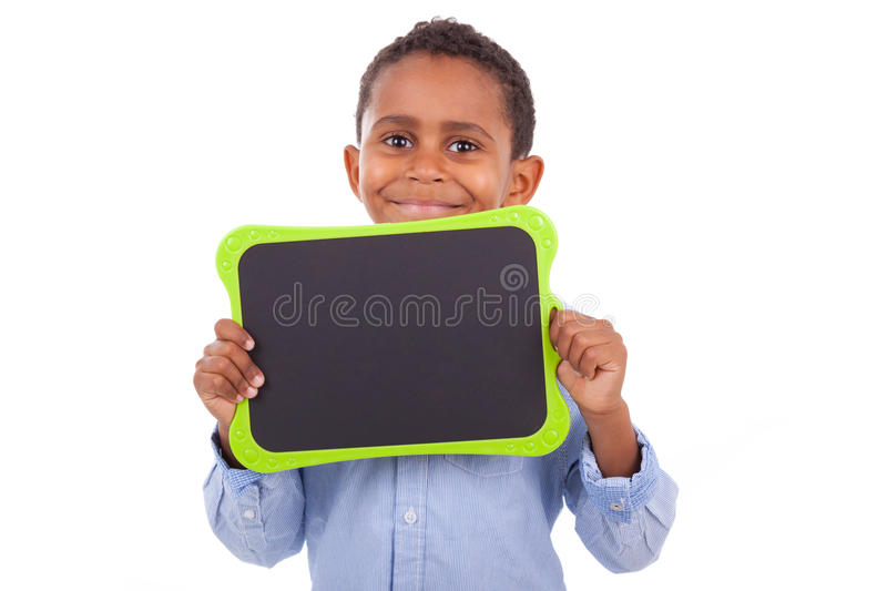 African American school boy holding a blank black board - Black stock images
