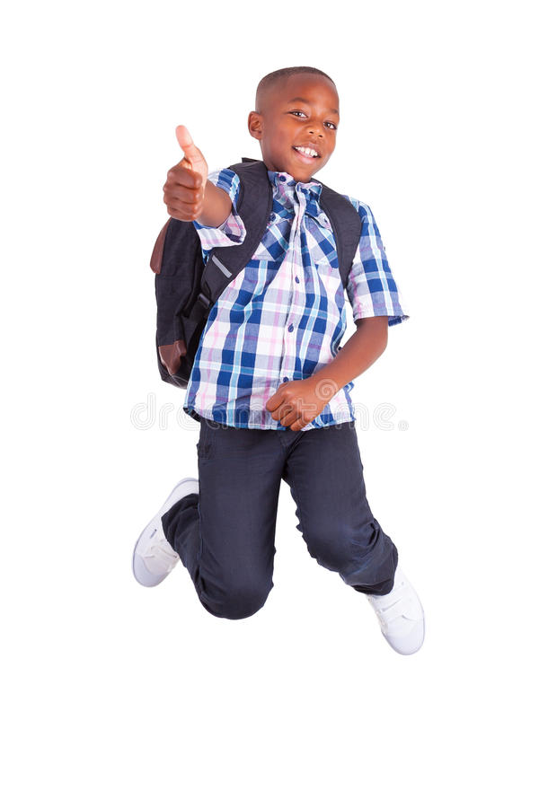 African American school boy jumping and making thumbs up - Black stock images