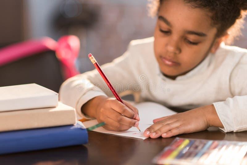 African american schoolgirl doing homework royalty free stock image
