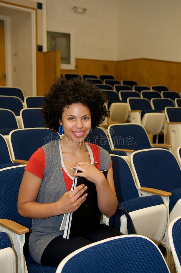 African American student in lecture hall stock images