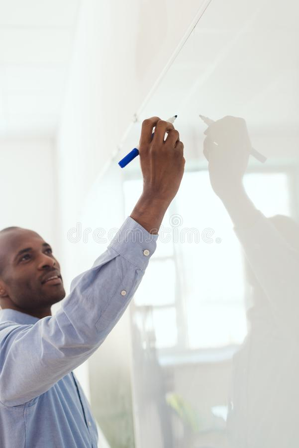 African american teacher writing on white royalty free stock images