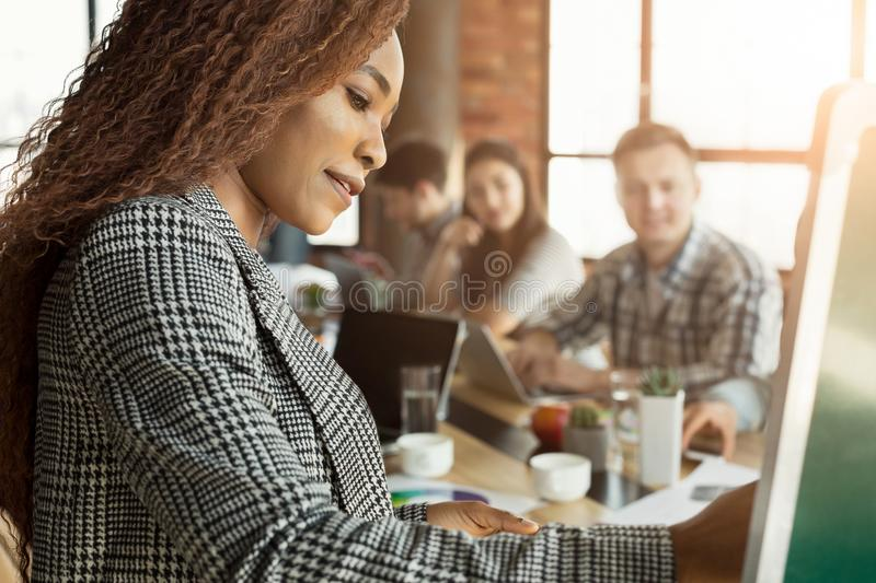 Cheerful businesswoman giving presentation to group royalty free stock photography