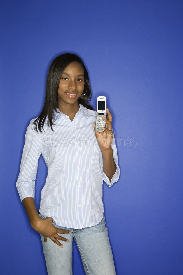 African-American teen girl holding cellphone. royalty free stock image