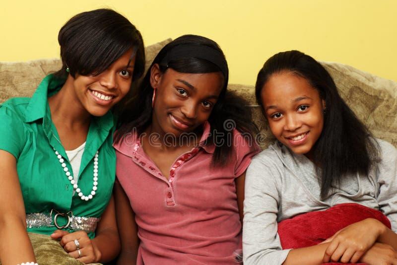 African American teenage sisters stock images