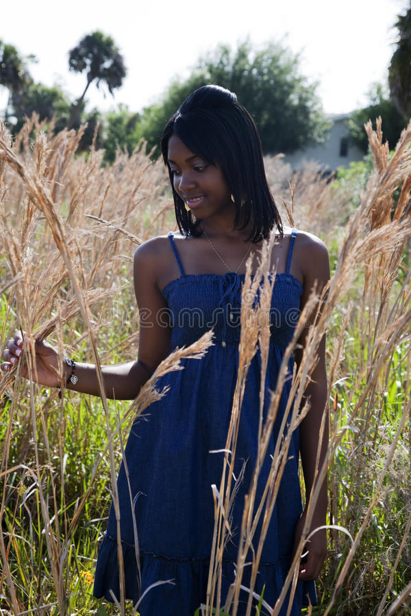 African American teenager in field stock photo