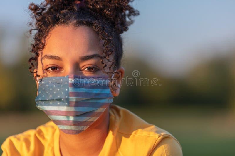 African American Teenager Girl Woman Wearing USA Flag Coronavirus COVID-19 Face Mask stock photo