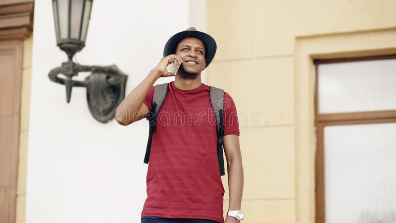 African american tourist man chatting with smartphone while travelling in Europe. An country stock photos