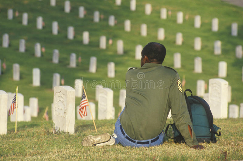 African-American Veteran Sitting in Cemetery, Los Angles, California stock images