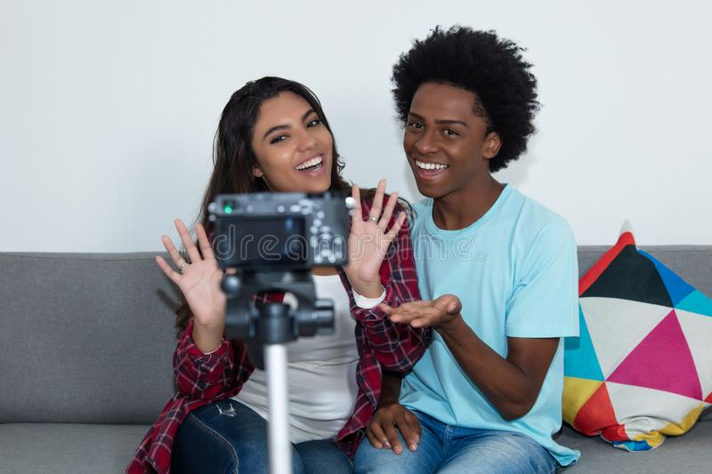 African american vlogger and influencer girl recording video blog stock image