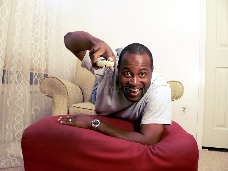 African american watching tv 2 stock photo