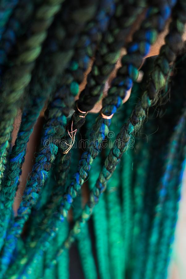 African American Woman with Beautiful Teal Green Blue Braids. In hair close up royalty free stock photography
