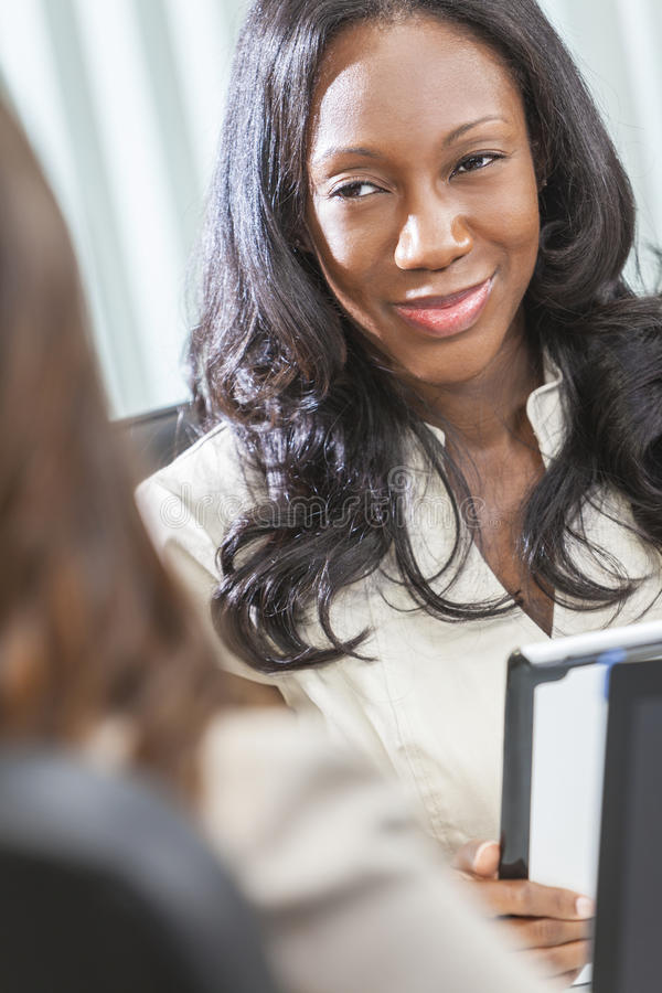 African American Woman or Businesswoman in Meeting stock photo