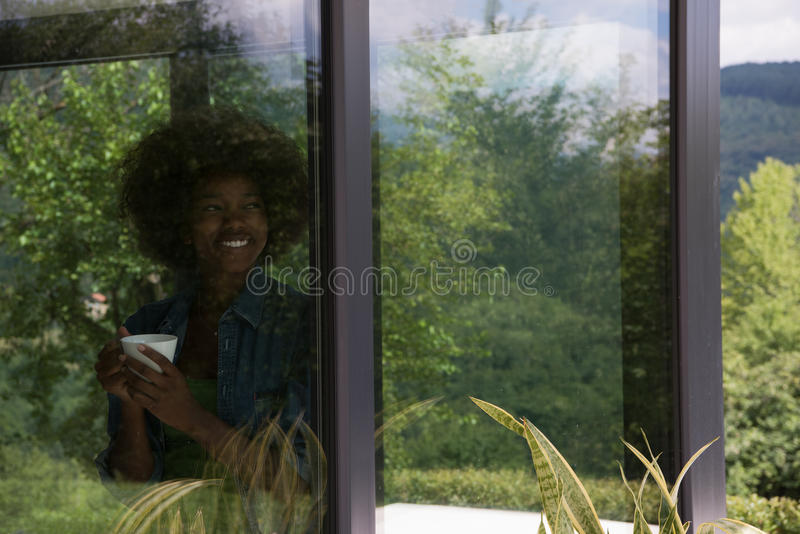 Download African American Woman Drinking Coffee Looking Out The Window Stock Image - Image: 83724613
