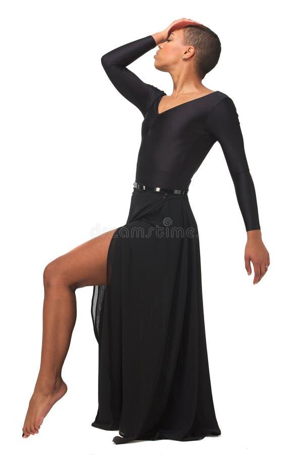 African American Woman Elegant Dance Pose. Young African American woman in elegant dance pose royalty free stock photo
