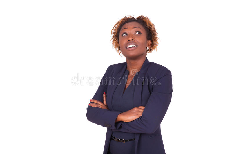 African American woman with folded arms looking up , isolated on. White background - Black people royalty free stock photo