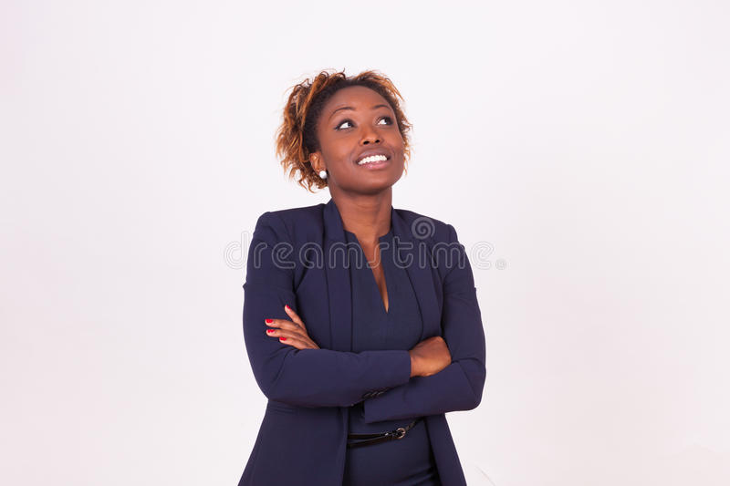 African American woman with folded arms looking up , on. White background - Black people stock image