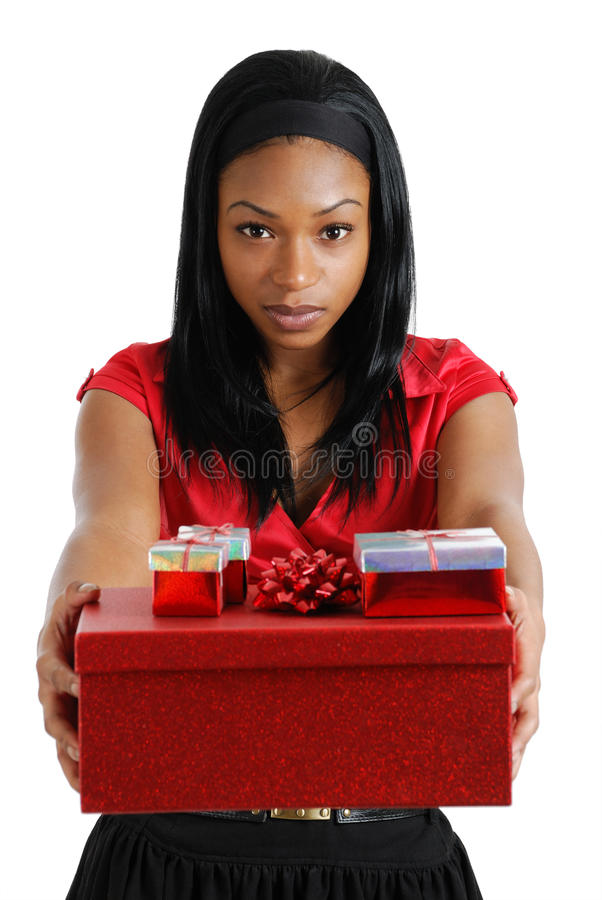 Free African American Woman Holding Christmas Present Royalty Free Stock Photos - 12021588