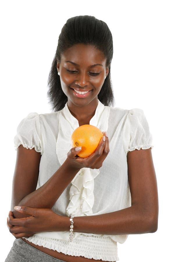 African american woman holding orange royalty free stock photos