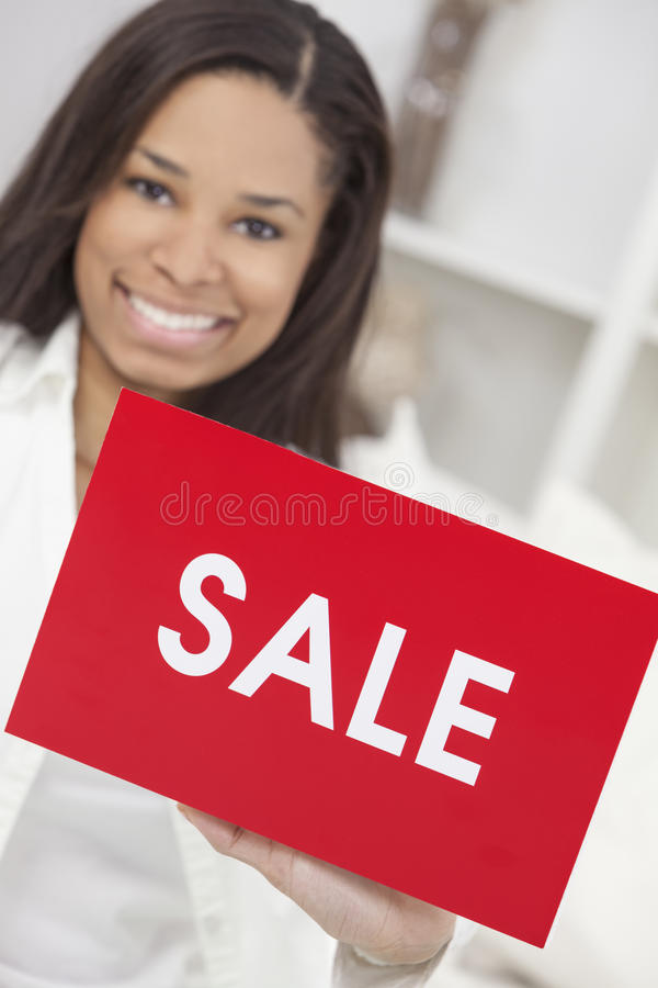 African American Woman Holding Sale Sign royalty free stock photo