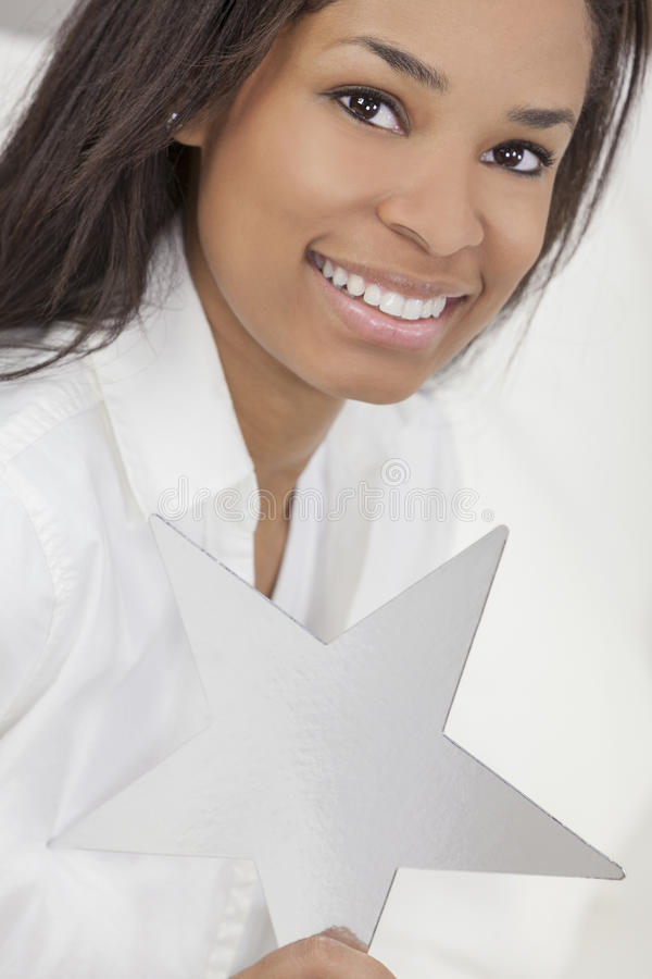 African American Woman Holding Silver Star royalty free stock photo