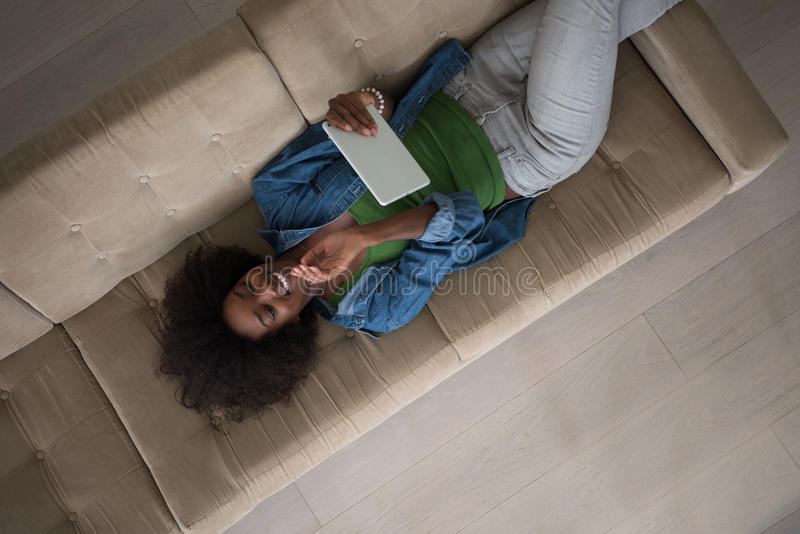 Download African American Woman At Home With Digital Tablet Top View Stock Image - Image: 83721393
