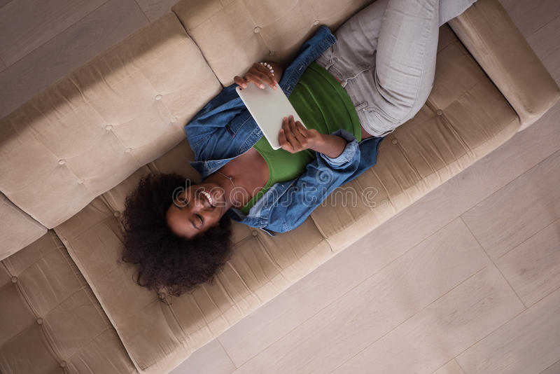 Download African American Woman At Home With Digital Tablet Top View Stock Photo - Image: 83721415