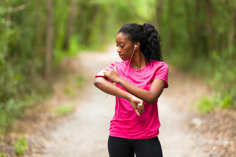African american woman jogger portrait - Fitness, people and h royalty free stock photos