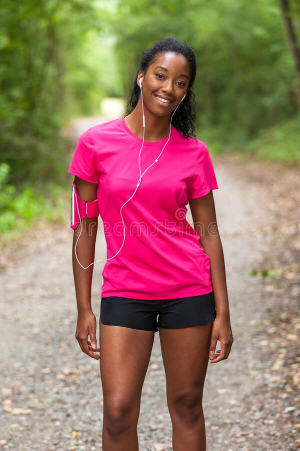 African american woman jogger portrait  - Fitness, people and healthy lifestyle stock photography
