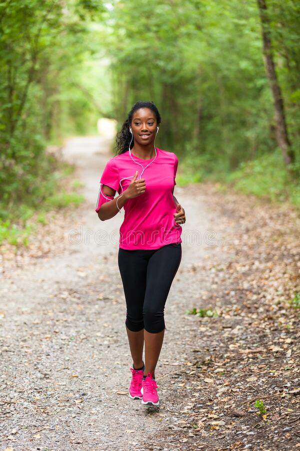 African american woman jogger portrait  - Fitness, people and healthy lifestyle stock photos