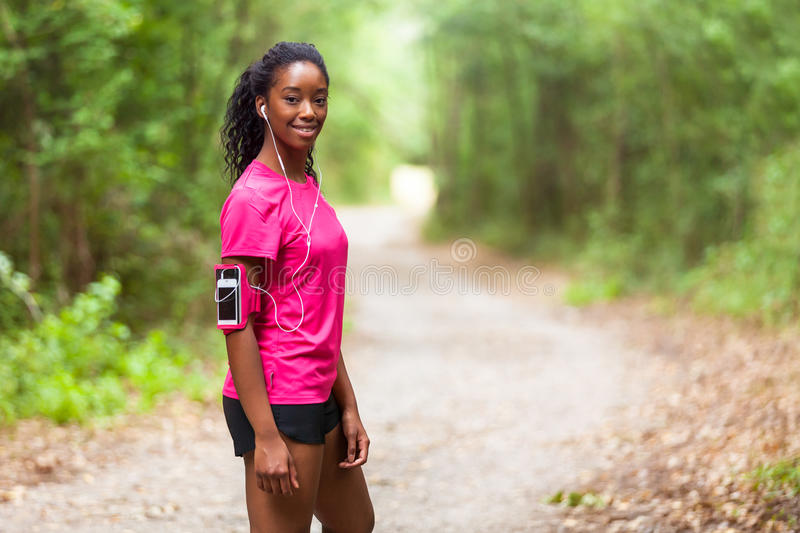 African american woman jogger portrait - Fitness, people and he royalty free stock images