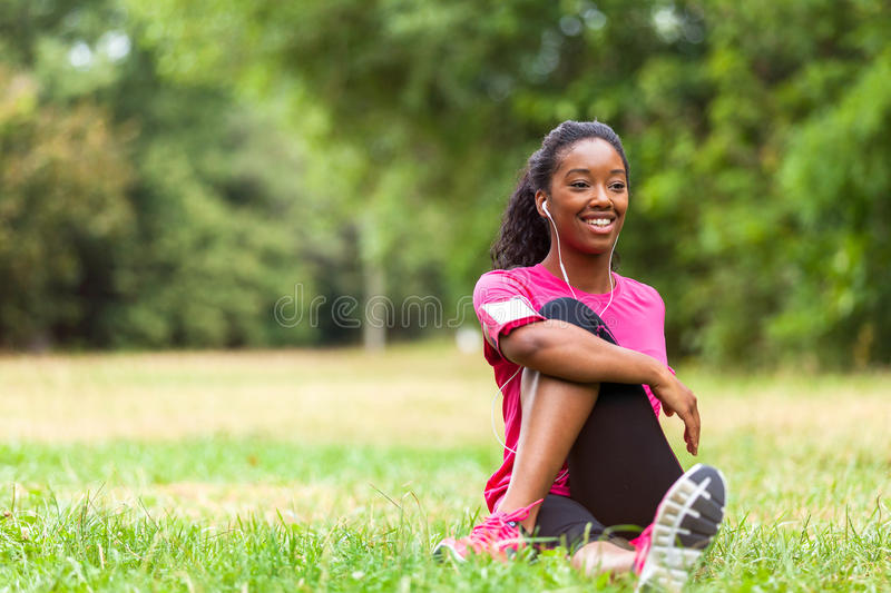 African american woman jogger stretching - Fitness, people and royalty free stock photography