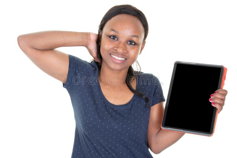 African American woman joyful presenting tablet to camera something on electronic black screen empty stock photography