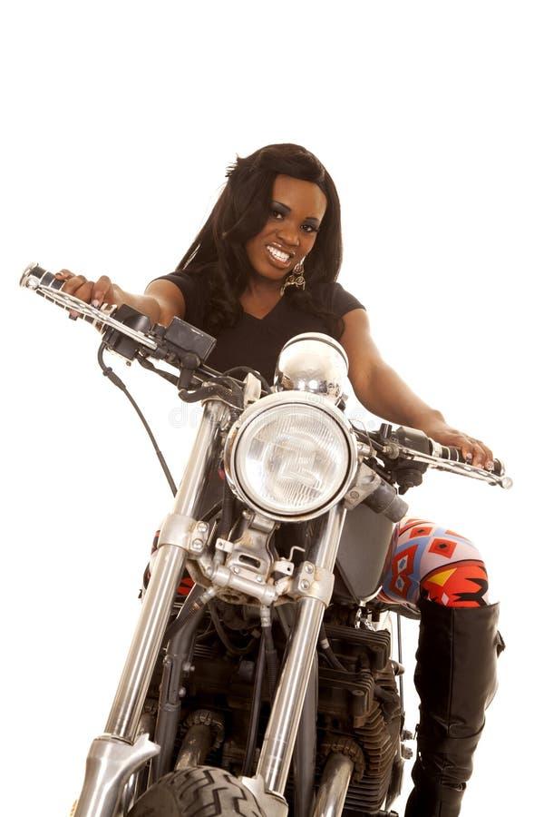 African American woman leggings motorcycle look stock photo