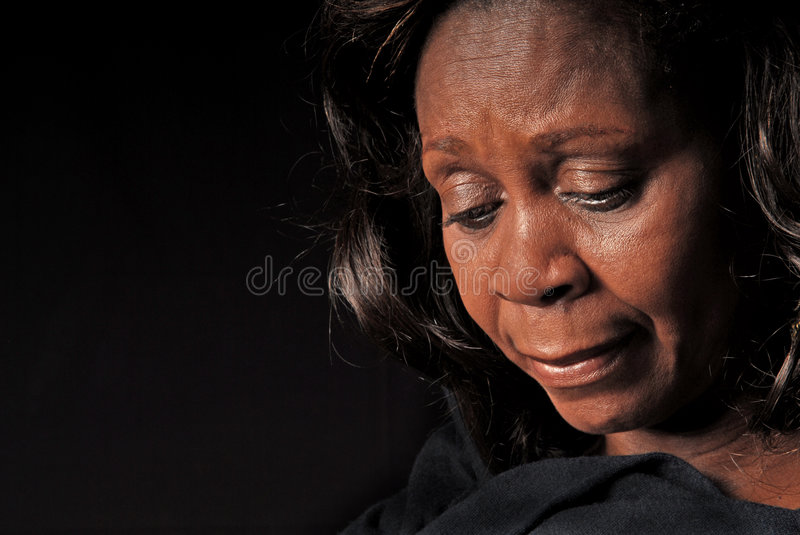 African American Woman Looking Down Royalty Free Stock Photos