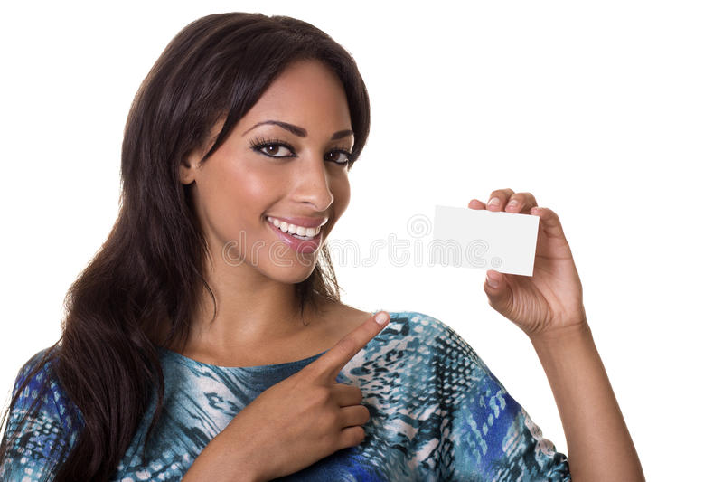 African american woman points to business card. Beautiful woman in a colorful top points to a blank business card stock image