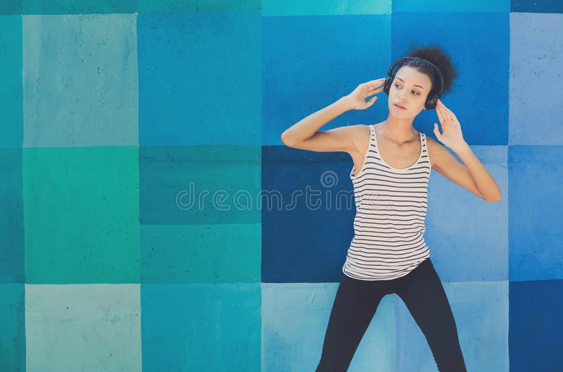 African-american woman posing at bright wall royalty free stock photo