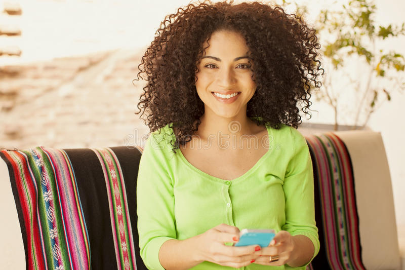 African american woman shoping with phone. African american woman having fun with mobile phone royalty free stock images