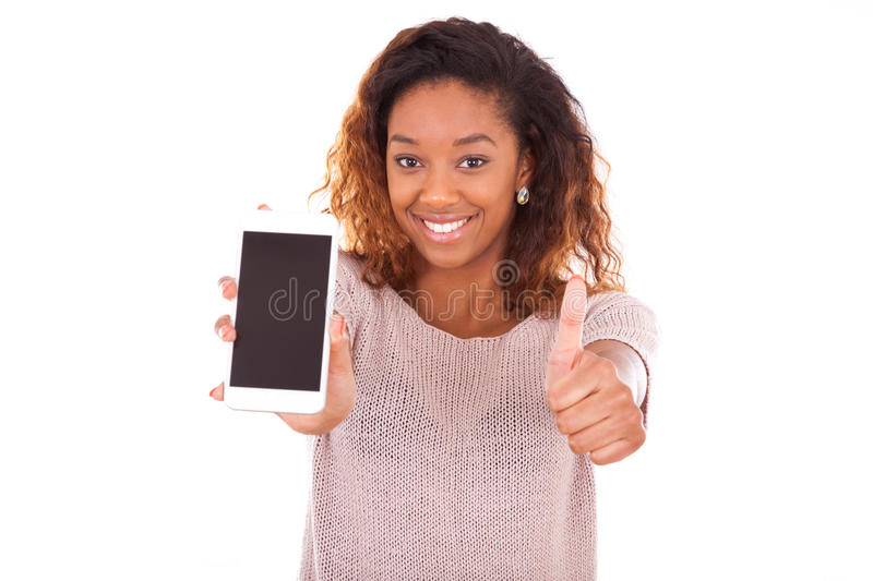 African American Woman showing a mobile phone and making thumbs stock image