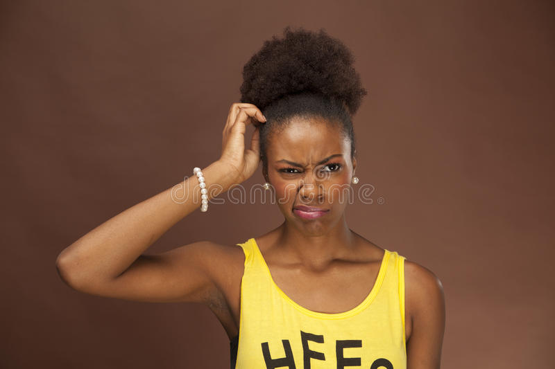 African American woman shows emotion with facial features