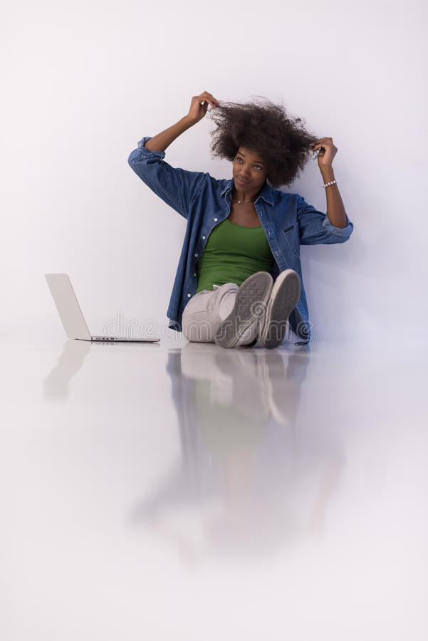 Download African American Woman Sitting On Floor With Laptop Stock Photo - Image: 83703760