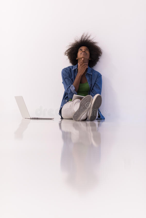 Download African American Woman Sitting On Floor With Laptop Stock Photo - Image: 83720672