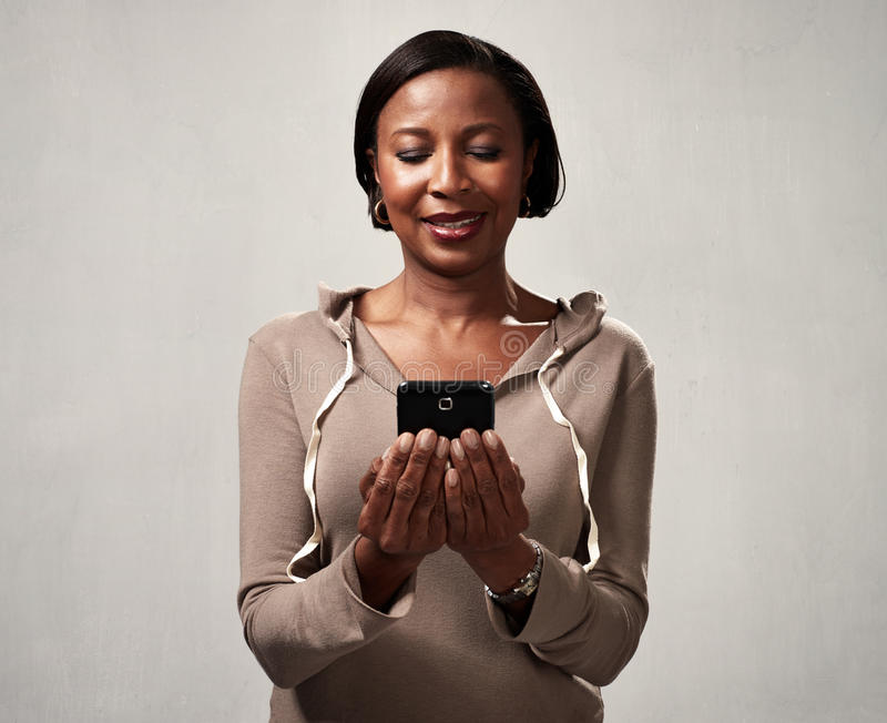 African american woman with smartphone stock photography