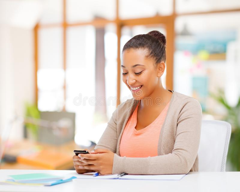 African american woman with smartphone stock images