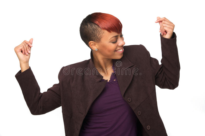 African American Woman Snapping her Fingers to Music. Beautiful African American woman snapping her fingers. She is dancing and enjoying music. Horizontal image stock image