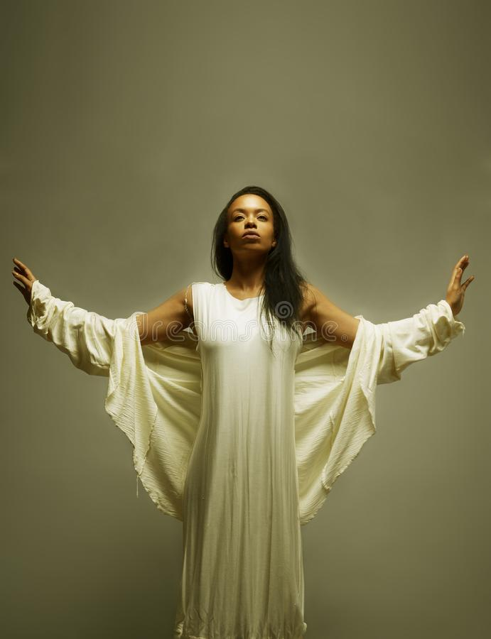 Beauty African American woman in angelic pose stock image