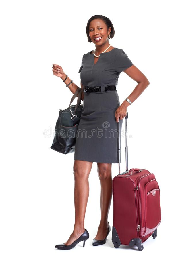 African-American woman with suitcase. Mature afro american woman with suitcase isolated white background royalty free stock photo