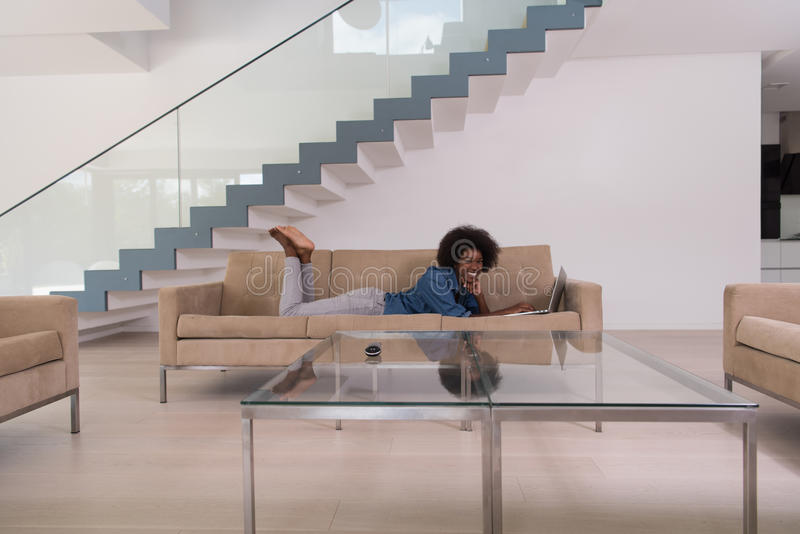 Download African American Woman Using Laptop On Sofa Stock Image - Image: 83719605