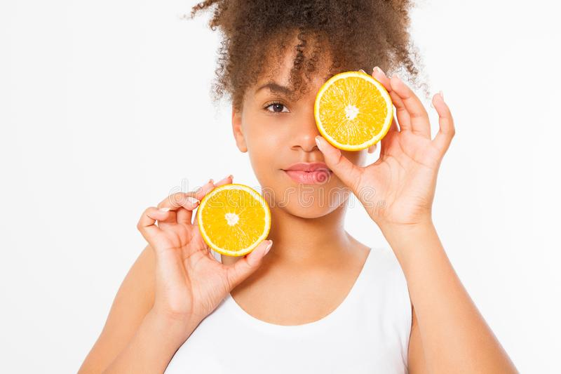 African american woman on white background. Afro girl and diet concept. Copy space. Oranges. Skin care, spa and make up. Beautiful young african american woman royalty free stock photos