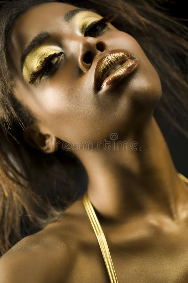 Free African American Woman With Golden Makeup Royalty Free Stock Images - 33895659
