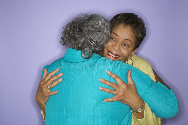 African American women embracing. stock photo